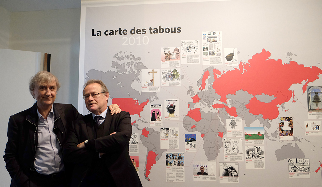 Plantu and Jacques Terrière in front of the Map of taboos 2010