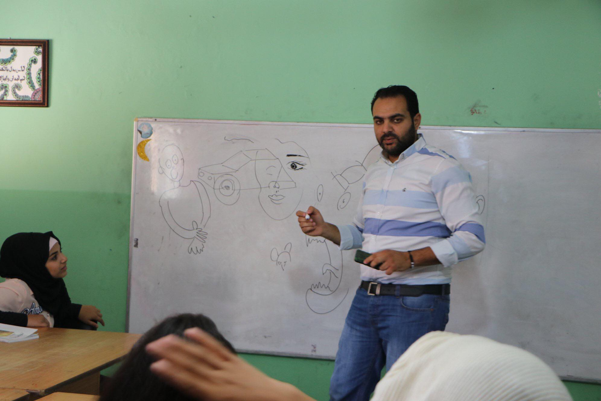 Osama Nazzal, cartoonist, at a workshop