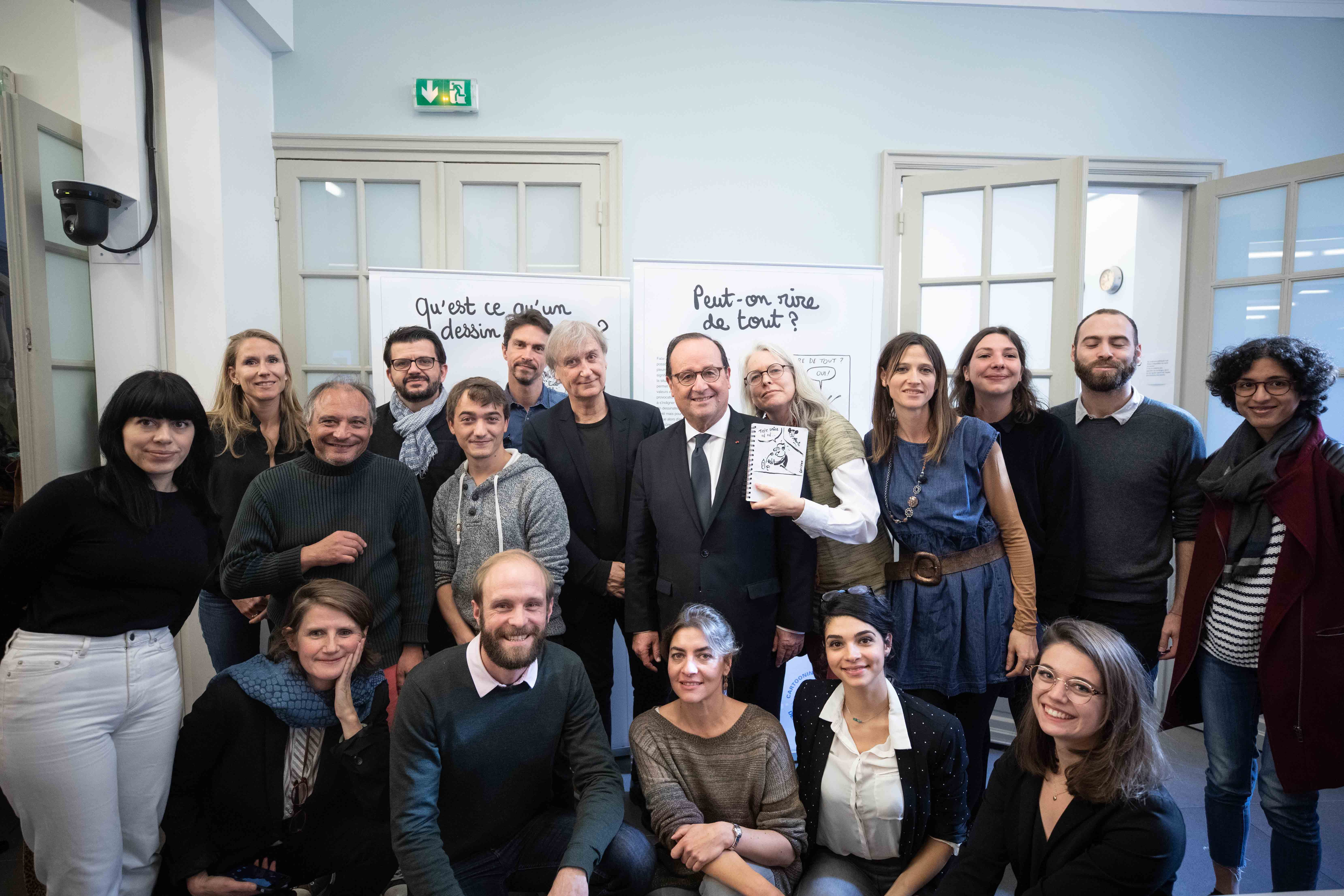 Cartooning for Peace team, cartoonists and François Hollande